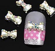 10pcs colorfull strass traversant nœud papillon blanc accessoires alliage d'ongles nail art décoration